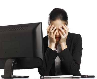 Young Businesswoman depressed looking at laptop